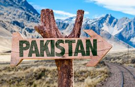 stock photo of skardu  - Pakistan wooden sign with desert road background - JPG