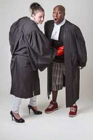 picture of toga  - woman punching a man in the gut both wearing canadian lawyers toga - JPG