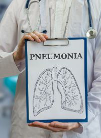 image of pneumonia  - Doctor holds clipboard with pneumonia diagnosis and lungs - JPG