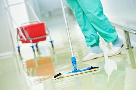 stock photo of hospital  - Floor care and cleaning services with washing mop in sterile factory or clean hospital  - JPG