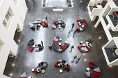 Постер, плакат: Overhead view of seating in a university atrium motion blur