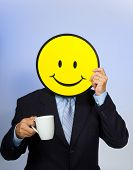Smiley face man drinking a cup of coffee -