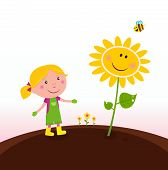 Spring gardening : Gardener child with sunflower in the garden