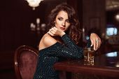 Beauty Young Brunette Woman Sitting At The Bar poster