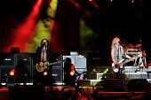 DUBLIN - JUNE 12 : Rick Savage (R) and Vivian Campbell (L) of Def Leppard rock group on stage during