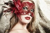 Beautiful Young Woman In A Red Mysterious Venetian Mask