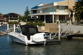 picture of pontoon boat  - A boat moored beside a luxury home Surfers Paradise Queensland Australia - JPG