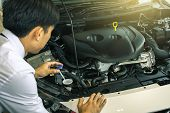 Asian Man With Technology Engine On Blurry Background.for Automotive Or  Maintenance, Service Or Tra poster