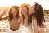 Image of three joyous multiethnic girls 20s in stylish clothing laughing and showing peace sign at c poster