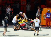 SEPANG, MALAYSIA - OCTOBER 21: MotoGP rider Casey Stoner returns to the garage after a free practice