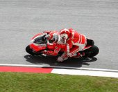 SEPANG, MALAYSIA - OCTOBER 23: A fan gets to ride on a two-seater Ducati motorcycle around the tracks at the Shell Advance Malaysian Motorcycle Grand Prix 2011 on October 23, 2011 at Sepang, Malaysia.