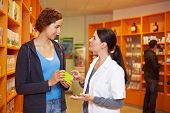 Pharmacist Advising Woman