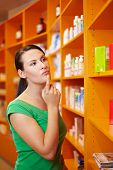 Woman In Pharmacy Thinking