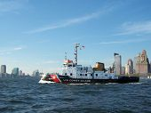picture of coast guard  - us coast guard boat leaving harbor  - JPG
