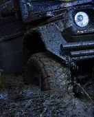 Extreme Entertainment Concept. Offroad Tire Covered With Mud Overcomes Obstacles On Nature Backgroun poster