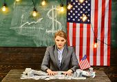 Economy And Finance. Economy Of America With Woman Holding Money At Flag poster