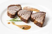 stock photo of deer meat  - Roasted deer meat sliced close up shoot - JPG