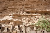 image of dogon  - The principal Dogon area is bisected by the Bandiagara Escarpment. The Dogon are best known for their mythology their mask dances wooden sculpture and their architecture. - JPG