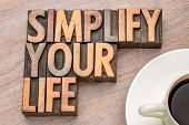 simplify your life advice - word abstract in vintage letterpress wood type with a cup of coffee poster
