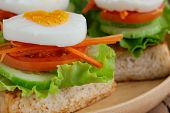 Close Up Open Faced Sandwich With Toast Lettuce Tomato Carrot Cucumber And Boil Egg. Grilled Sandwic poster