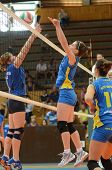 KAPOSVAR, HUNGARY - OCTOBER 2: Kamilla Gyorbiro (C) in action at a Hungarian NB I. League volleyball