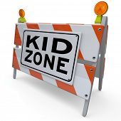 An orange and white construction barricade sign blocking an area that is a designated Kid Zone where children can safely gather and play or learn in an outdoor park or school classroom