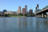 Portland Oregon Skyline & Bridge From The River.