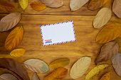 Blank Air Mail Envelope On Wooden Background With Orange Leaf. Empty Envelope In Autumn Seasonal Dec poster
