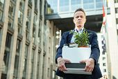 Office Case. Dismissed Professional Office Man Taking His Office Case With Document And Plants Home poster