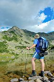 Hiker At Prevalski Lake In National Park Pirin