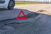Large Deep Pothole An Example Of Poor Road Maintenance Due To Reducing Local Council Repair Budgets poster