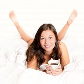 Beautiful Young Woman Drinking Coffee In Bed