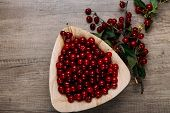 Fresh Red Cherries In A Wooden Plate On A Wooden Table. Wooden Plate On A Wooden Background. Next To poster