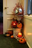 Cozy Fall Decorations with Candles and Pumpkins