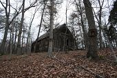 stock photo of 1700s  - An old church from the 1700s abandoned in the forest - JPG