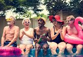 Group of diverse senior adults sitting by the pool enjoying summer together poster
