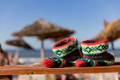 Christmas Sock At Exotic Tropical Beach. Holiday Concept For New Years Cards. Christmas Socks. Hand- poster