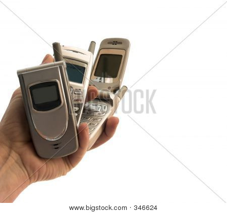 Picture or Photo of Isolated hand and cell phones - focus on the flip top
