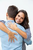 Young Couple In Love Hugging. Beautiful Cheerful Young Couple Hugging, Woman Smiling At Camera On Wh poster