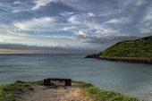 Empty Lava Rock Bench With Vast Sea And Scenic Skies On Backround At Hamdeok Beach On Jeju Island poster