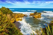 Pancake Rock is a natural wonder of Paparoa National Park, New Zealand. Scenic coastline, powerful s poster