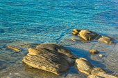 Picturesque Coast Landscape Sea Lagoon In Morning Sun Rise Time Stones And Bright Colorful Aquamarin poster