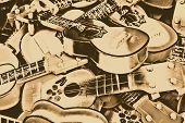 stock photo of ukulele  - Miniature guitars done in sepia light - JPG