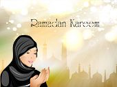 Ramadan Kareem or Ramazan Kareem background with Muslim girl in hijab reading Namaz and Mosque or Ma