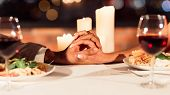 Romantic Date. Unrecognizable Spouses Holding Hands Interlocking Fingers On Served Table Having Dinn poster