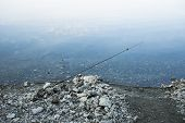 Fishing Passion Hobby Concept Picture With Rod Above Calm Water Surface On Shore Line Outdoor Backgr poster