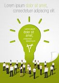 Green template in shape of light bulb idea with business people