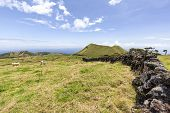 Rock Walls Bordering Cattle Pastures On The Eastern Edge Of Pico Island In The Azores. poster