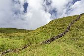 A Man Made Rock Wall On The Hilly Pastures On Pico Island In The Azores, Portugal. poster