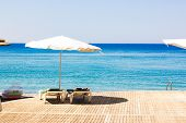 White Lounge Umbrella Waterfront Beach Resort Hotel Relaxation Space Red Sea Landscape Coast Line Bl poster